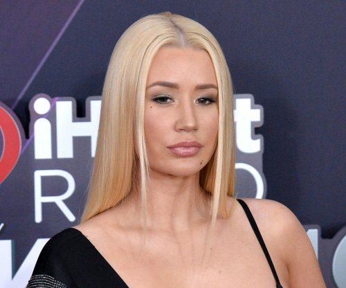 Iggy Azalea defends racy photos as 'creative' outlet