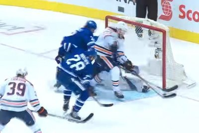 Oilers' Leon Draisaitl slices through Maple Leafs' defense for goal