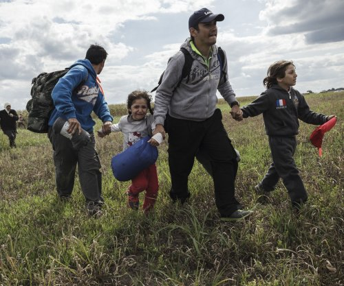 Migrants in Hungary break through police lines over camp conditions