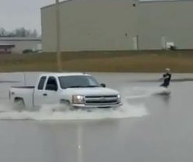 Indiana men go wakeboarding in flooded parking lot