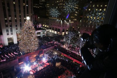 Rockefeller tree glistens with 50,000 lights, 500-pound star