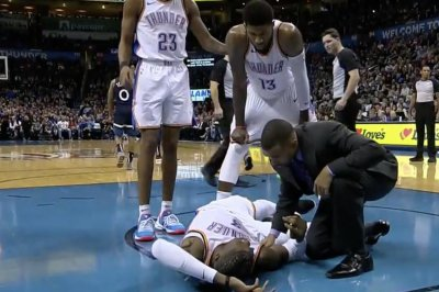 Nerlens Noel stretchered off court after Andrew Wiggins dunk attempt