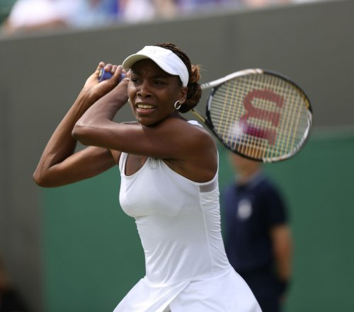 Serena, Venus Williams advance in Cincy