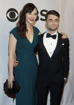 Daniel Radcliffe poses with girlfriend Erin Darke at Tony Awards red carpet