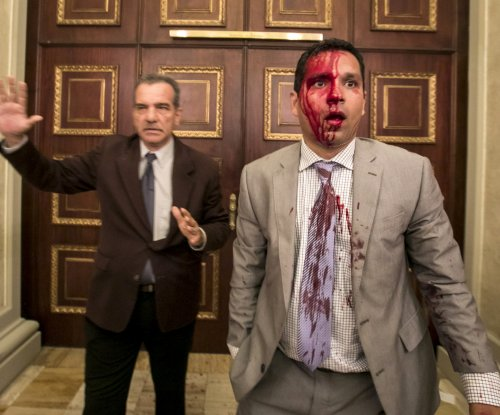 Venezuela lawmakers injured in protesters' attack on parliament