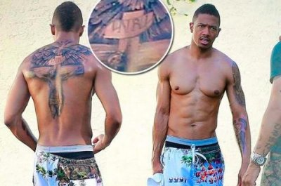 Nick Cannon covers 'Mariah' tattoo with religious statement