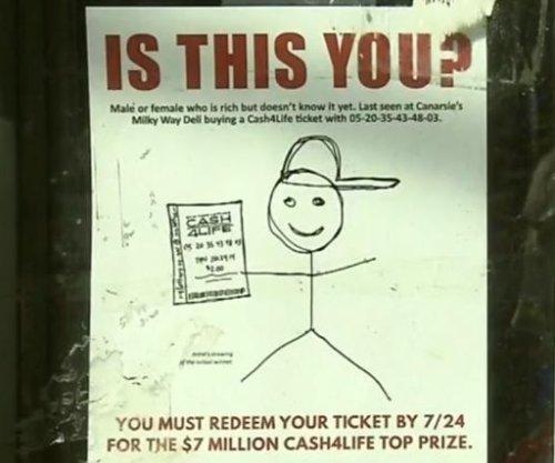 NY Lottery using stick figure posters to seek winner