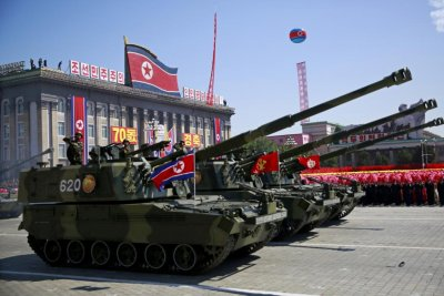 North Korean media reports military parade, without missiles