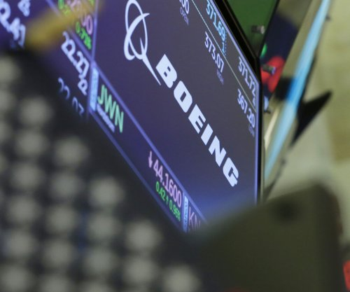Boeing reports $1 billion hit from fallout over 737 Max crashes