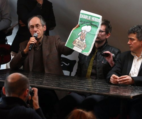 New Charlie Hebdo cover finds Mohammed crying, declaring 'Je Suis Charlie'