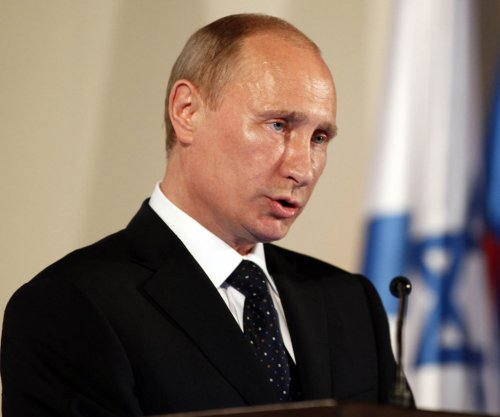 Russian President Putin orders withdrawal of troops from Syria