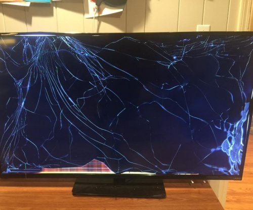 Missouri dad throws 30-pound TV to ward off armed home invader