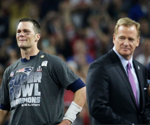 Tom Brady accepts Super Bowl MVP trophy from Roger Goodell