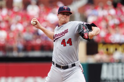 Twins, Royals tangle, aim to get something good going