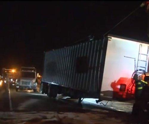 Semi crash covers California highway in grape pulp