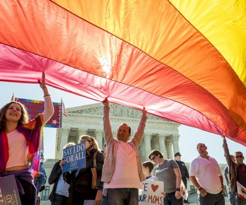 Washington state court rules for gay couple in wedding flower case