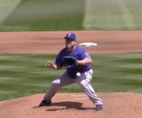 Rangers' Bartolo Colon takes 102-mph hit to gut, still makes out