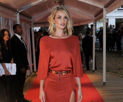 Rosie Huntington-Whiteley stuns in red dress at Glamour Awards