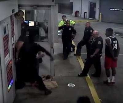 Florida officer charged for punching cuffed woman