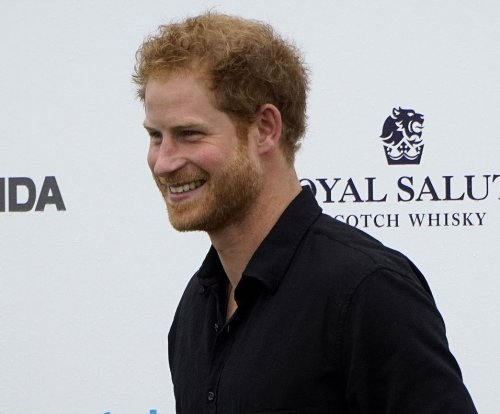Prince Harry joins Coldplay on stage at HIV benefit