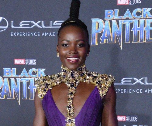 Lupita Nyong'o celebrates her 'kinky' curls: 'I love my hair'
