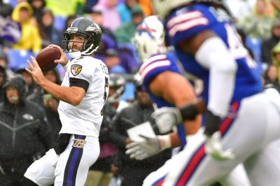 Joe Flacco hits on all cylinders, Baltimore Ravens crush Buffalo Bills