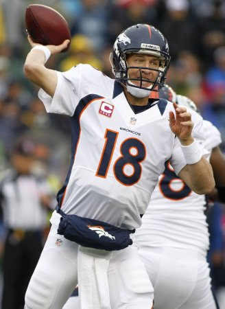Manning, Rodgers receive NFL honors