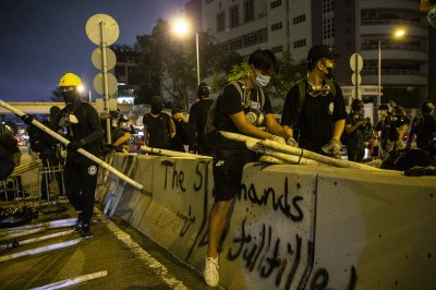 Hong Kong police use tear gas on protesters, airport sit-in marks second day