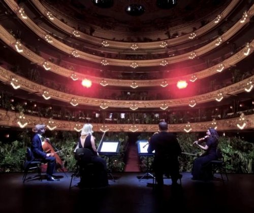 Quartet plays to audience of potted plants at Spanish opera house