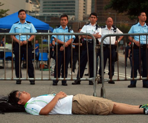 Hong Kong protest leader considers lawsuit after arrest