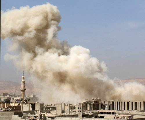 Britain joins Syria airstrikes, Islamic State loses ground