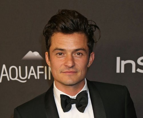 Orlando Bloom goes paddleboarding naked with Katy Perry