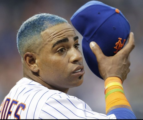 New York Mets slugger Yoenis Cespedes dyes hair bright blue