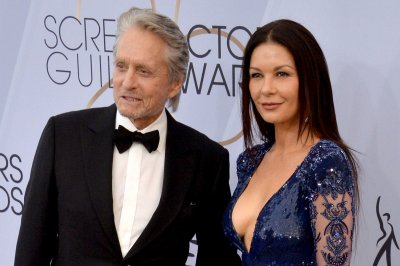 Michael Douglas, Catherine Zeta-Jones wish Kirk Douglas a happy 103rd birthday