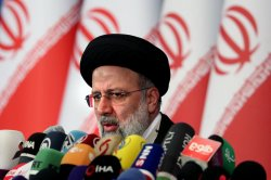 Iran blasts 'unilateralism' as it joins group headed by China, Russia