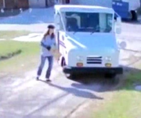 USPS driver throws package, runs a lap around van