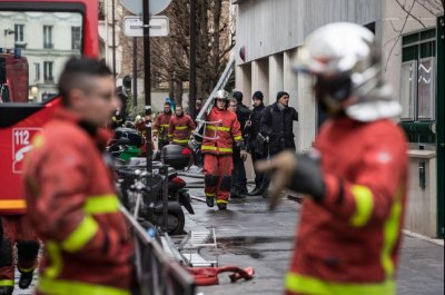 Paris apartment fire kills at least 10; arson examined