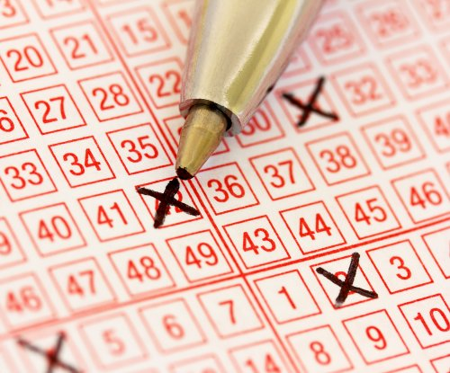 Mistake at the store doubles woman's lottery prize to $1.4 million