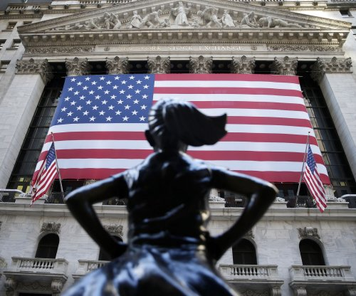 Dow climbs 328 points amid more positive COVID-19 vaccine news