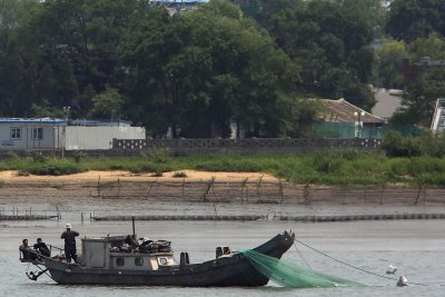 Japan searching for capsized North Korea boat, report says