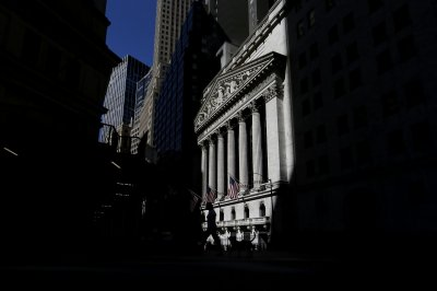 Dow claws back some losses, begins week with slight gains