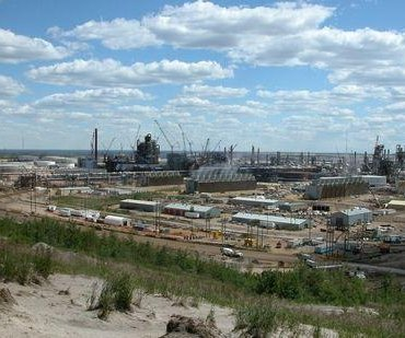 Alberta asked to review Suncor bid for rival