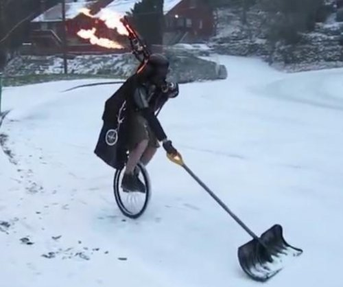 Portland man shovels snow while riding unicycle, playing bagpipes
