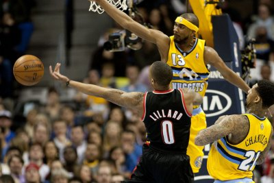 Damian Lillard, Blazers hold off Pacers
