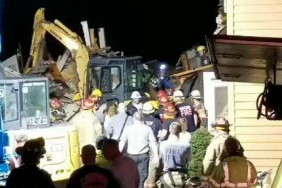 North Carolina landslide collapses home, kills 2