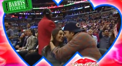 Ashton Kutcher and Mila Kunis kissed on 'Kiss Cam' day before pregnancy reveal