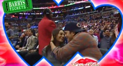Ashton Kutcher and Mila Kunis kissed on 'Kiss Cam' day before pregnancy reveal