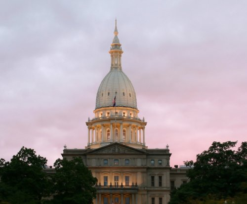 Satanists, Christians compete for attention at Michigan statehouse