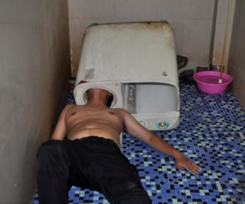 Firefighters free man's head from washing machine in China