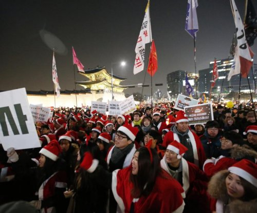 South Korean protesters use Santa outfits to call for Park's ouster